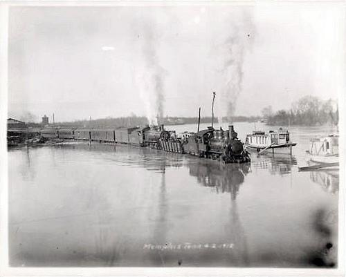 A train in Memphis finds the tracks are submerged. Flood of 1912.